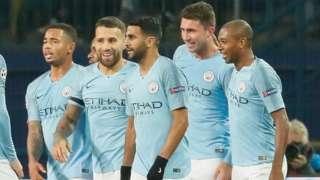 Manchester City's players celebrate scoring against Shakhtar Donetsk in the Champions League