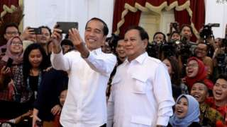 Joko Widodo and Prabowo Subianto pose for a selfie