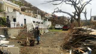 People clear damage in Tortola