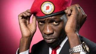Bobi Wine adjusting his red beret
