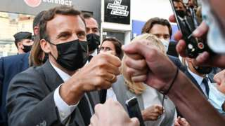 French President Emmanuel Macron (L) and his wife Brigitte Macron (C) salute people in Valence, France, 08 June 2021