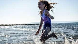 Girl splashing in seawater