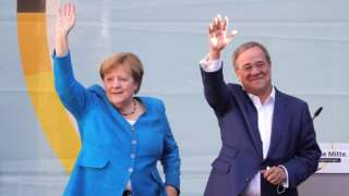 Christian Democratic Union (CDU) party chairman and top candidate for the upcoming federal elections Armin Laschet (R) and German Chancellor Angela Merkel (L) during the election campaign closing of the CDU in Aachen, Germany, 25 September 2021.