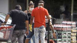 People buy products with US dollars at a store in Havana on July 20, 2020 as Cuba eliminated the dollar tax to boost the economy amid the COVID-19 novel coronavirus pandemic.