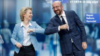 European Council President Charles Michel and European Commission President Ursula Von Der Leyen do an elbow bump at the end of a news conference following a four-day European summit at the European Council in Brussels, Belgium, July 21, 2020.