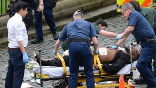 Khalid Massood being treated at the scene of the Westminster attack