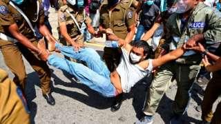 Sri Lanka police manhandle a protester