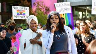 Blossom C. Brown speaks and Stand Up in Solidarity rally organizer Ashlee Marie Preston looks on as Trans employees and allies at Netflix walkout in protest of Dave Chappelle special on October 20, 2021 in Los Angeles, California