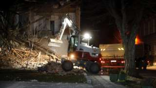 Workers clear a building damaged in an earthquake in Petrinja, Croatia, 29 December 2020