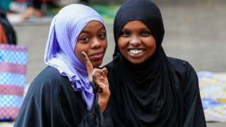 Worshippers pose for a photo after performing Eid prayers at the Masjid Noor Mosque in Nairobi, Kenya