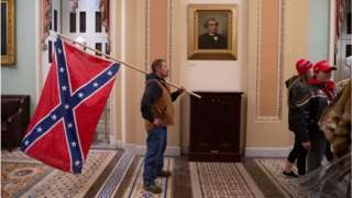 Man seen carrying a Confederate flag in the US Capitol
