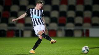 Newcastle player kicking football