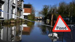 A sign warns of flooding in Tewkesbury, Gloucestershire