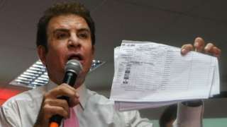 "The presidential candidate for Honduras"" Opposition Alliance against the Dictatorship, Salvador Nasralla, holds up vote tallies that he claims show that he won the November 26 general elections, in Tegucigalpa on November 29, 2017."