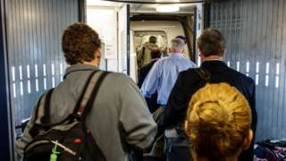 Passengers boarding a flight.