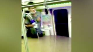 Man stands in flooded subway carriage, China