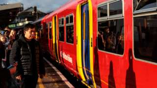 Crowds wait for a South Western Railway service