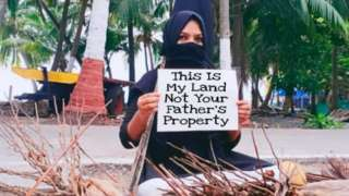 A woman protesting in Lakshadweep