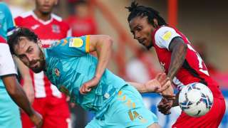 Ed Upson of Newport County and Jevani Brown of Exeter City compete for the ball
