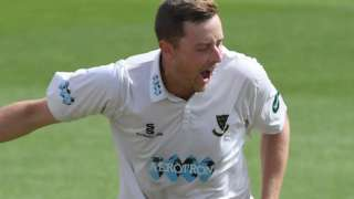 Ollie Robinson celebrates a wicket for Sussex