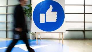 Worker outside a Facebook office