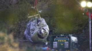 Helicopter removed from wreckage