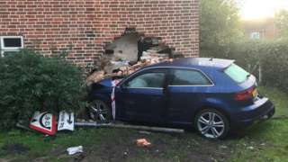 Car driven into house