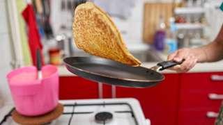 Pancake cooking in frying pan