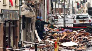 Police forensic investigators at the scene of the Omagh bombing