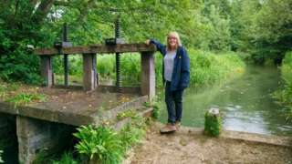 Clare Mahdiyone standing by the millpond