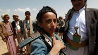 An armed Yemeni boy loyal to the Houthi movement at a tribal gathering in Bani al-Harith, north of Sanaa (17 August 2014)