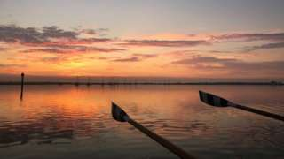 Rowers on water at sunrise close to Hayling Island in Hampshire