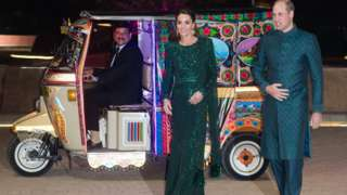The Duke and Duchess of Cambridge arrive at the Pakistan Monument by auto rickshaw
