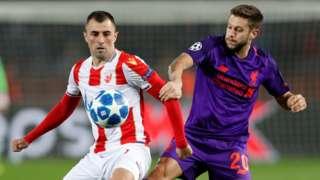 Crvena Zvezda's Nenad Krsticic in action with Liverpool's Adam Lallana