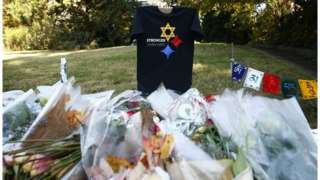 "A ""Stronger Than Hate"" t-shirt, messages, and flowers are left near the Tree of Life synagogue three days after a mass shooting in Pittsburgh, Pennsylvania"