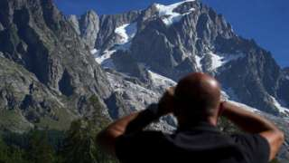 Man looking at mountains in background