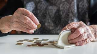 Older woman counting coins