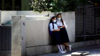 Girls wearing protective face masks look on in Tel Aviv, Israel September 15, 2020