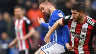 Ipswich Town's Luke Chambers (left) and Sheffield United's Ched Evans battle for the ball