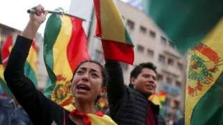 Protesters celebrate about Bolivian President Evo Morales announces his resignation