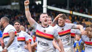 Bradford's Connor Farrell celebrates Mikey Wood's try against Leeds