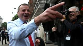 Arron Banks arriving at a Commons select committee meeting