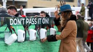 Race goers use hand sanitiser installed at Cheltenham Racecourse to help curb the spread of the Corona Virus at Cheltenham Racecourse on March 10, 2020 in Cheltenham, England.