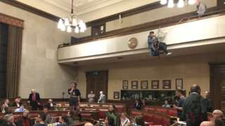 Cambridge City Council chamber and protesters