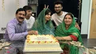 Malala celebrating graduation with family