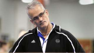 Gymnastics coach John Geddert watches his students during a practice in Lansing, Michigan, U.S. December 14, 2011