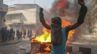 Opposition supporters of leader Ousmane Sonko clash with security forces during a protest in Dakar, Senegal 05 March 2021