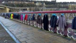 The coats hanging on the bridge