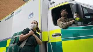 Paramedic with soldier at ambulance