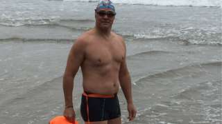 Stuart Hindes at edge of sea